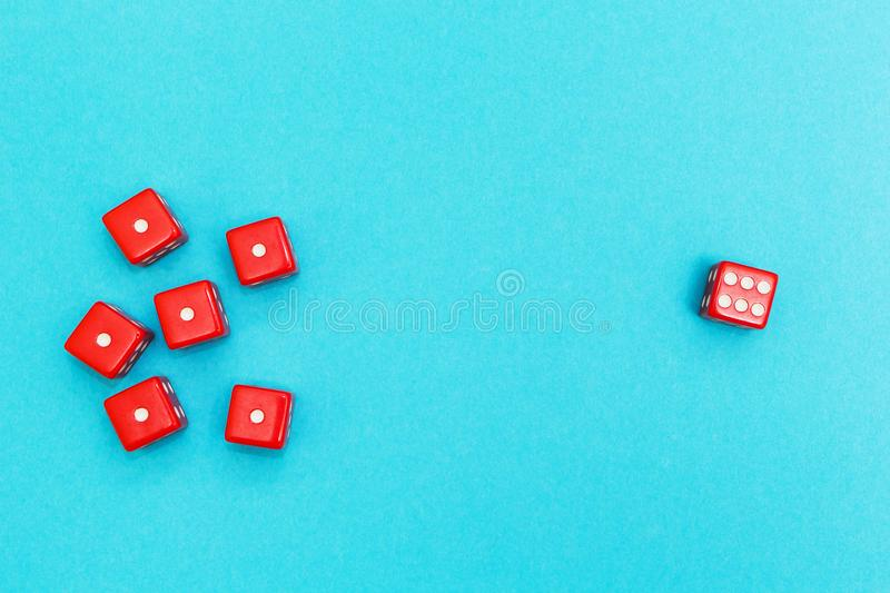 Red dice on a blue background, success and failure royalty free stock images