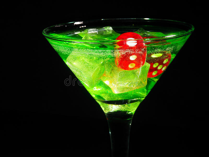 Red dice in a cocktail glass on black background. casino series royalty free stock images
