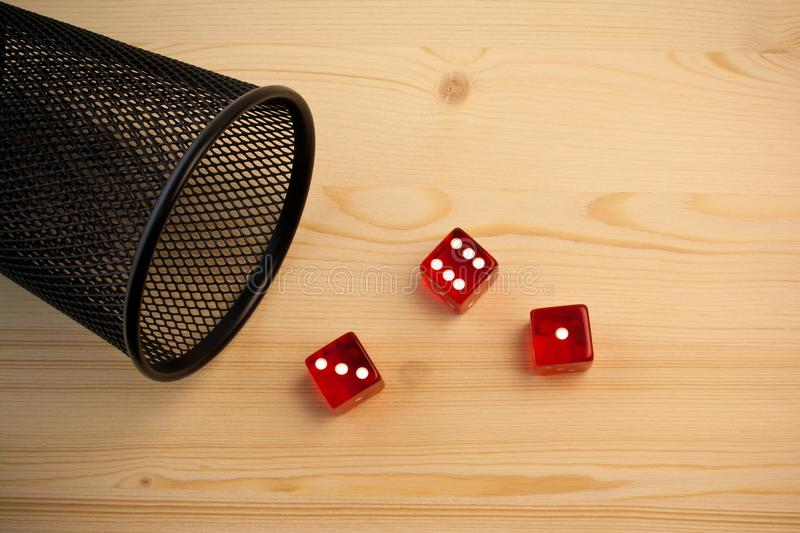 Red dice near a container royalty free stock images