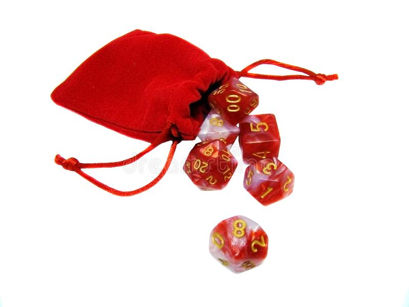 Red dice in a red pouch royalty free stock image