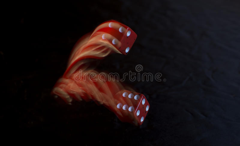 Red Dice Rolling royalty free stock photography