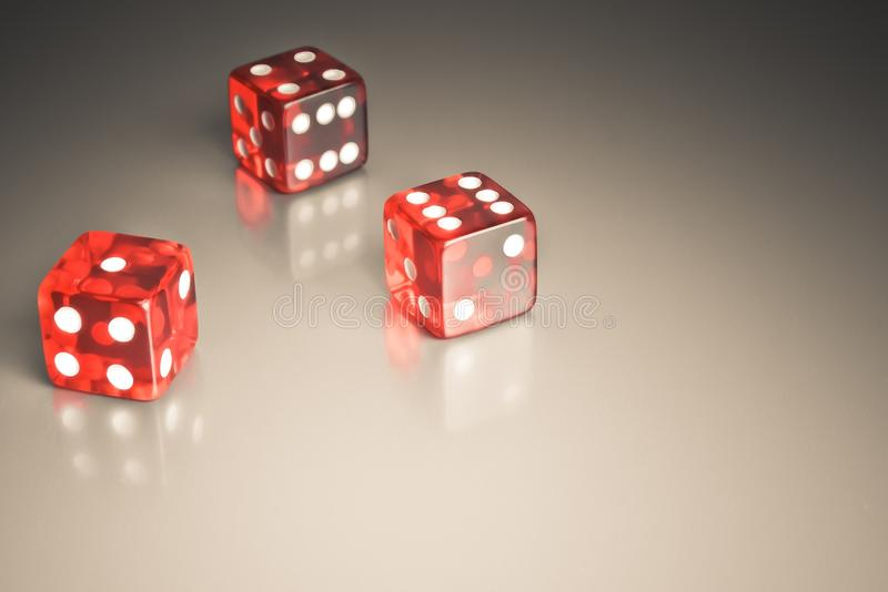 Red dice on a smooth surface royalty free stock photos