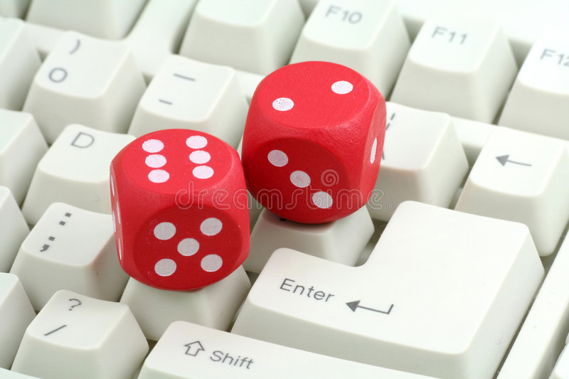 Red dices and keyboard stock images