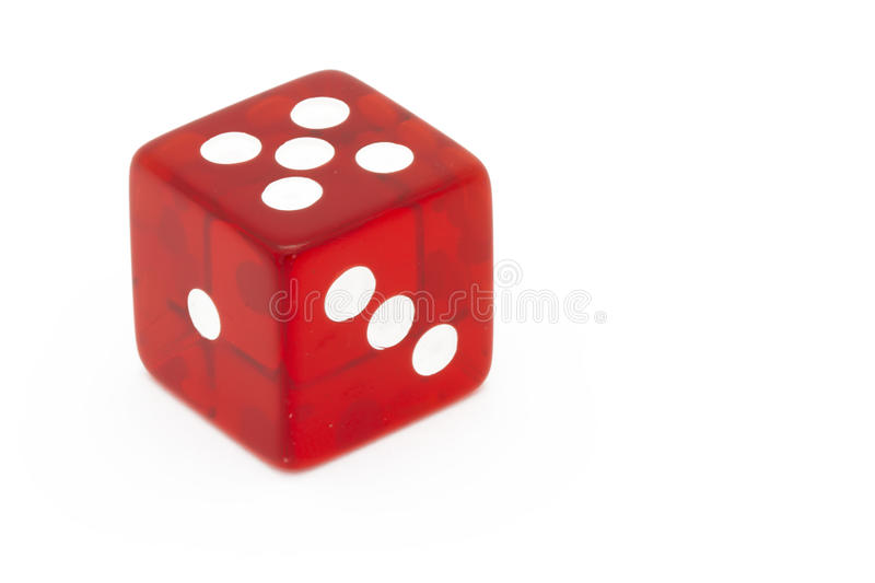 Red die. On white background royalty free stock photos