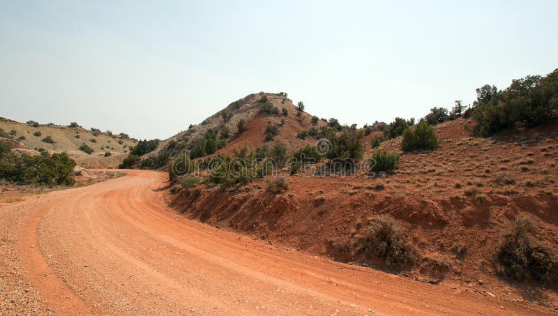 Red dirt and gravel Crooked Creek Road through the Pryor Mountains in Wyoming stock photos