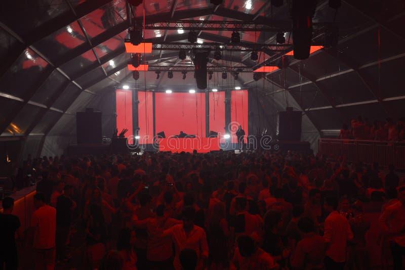 Red Disco Lights, People, Music, Sound, NightClub DJ. Manta Beach is a Summer nightclub on a giant transparent tent at Manta Rota, Algarve stock photo