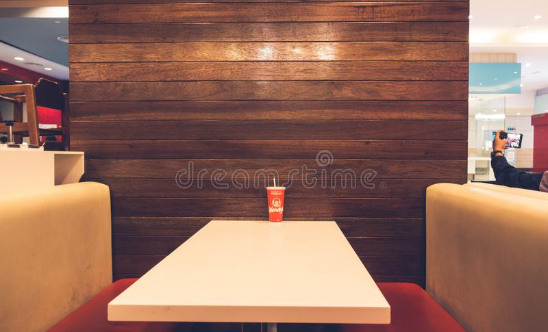 Red Disposable Cup on White Table royalty free stock photos