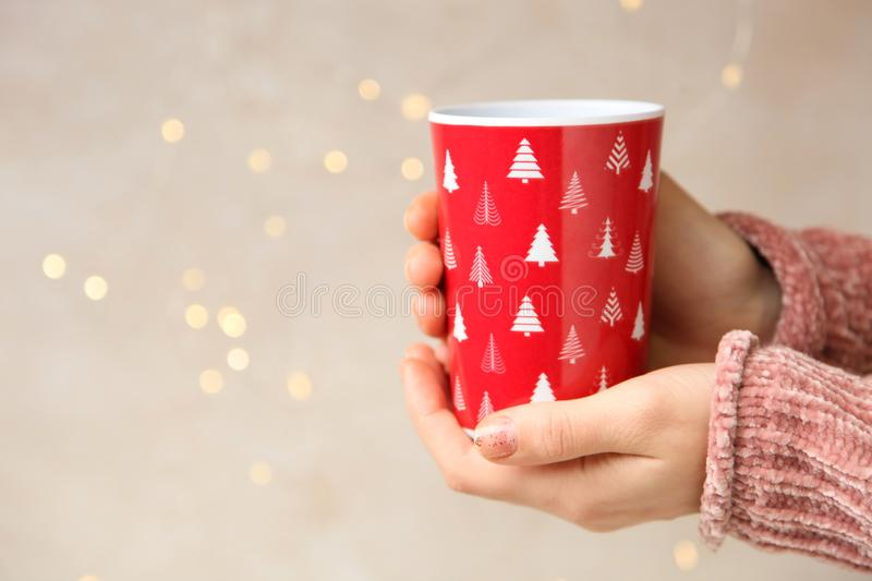 Red disposable glass in hand stock photo