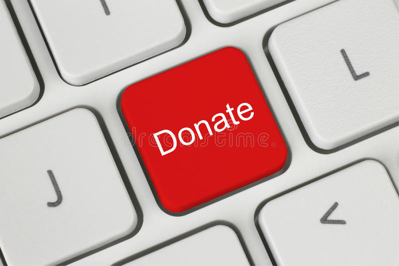 Red donate button on the keyboard. Close-up stock photo