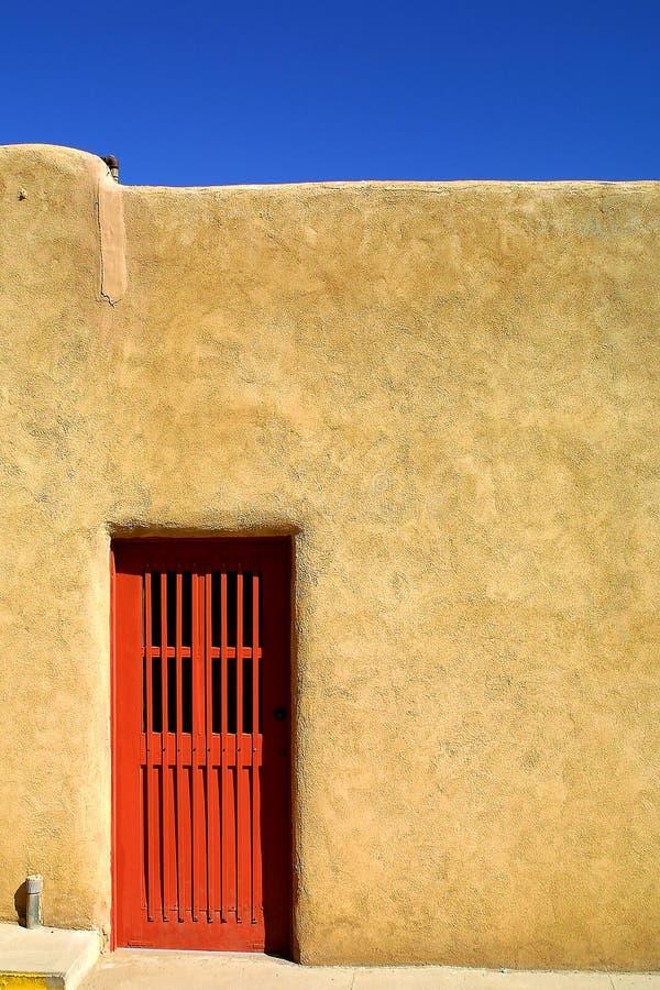Red Door. Of Adobe house