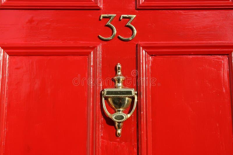 Red door. Classical british home door of victorian red color