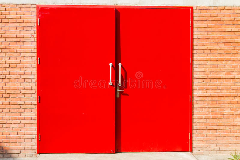 red door in a brick wall royalty free stock photography