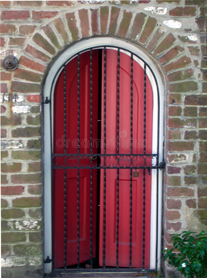Download Red Door behind Iron Gate stock photo. Image of gate, locked - 1032028