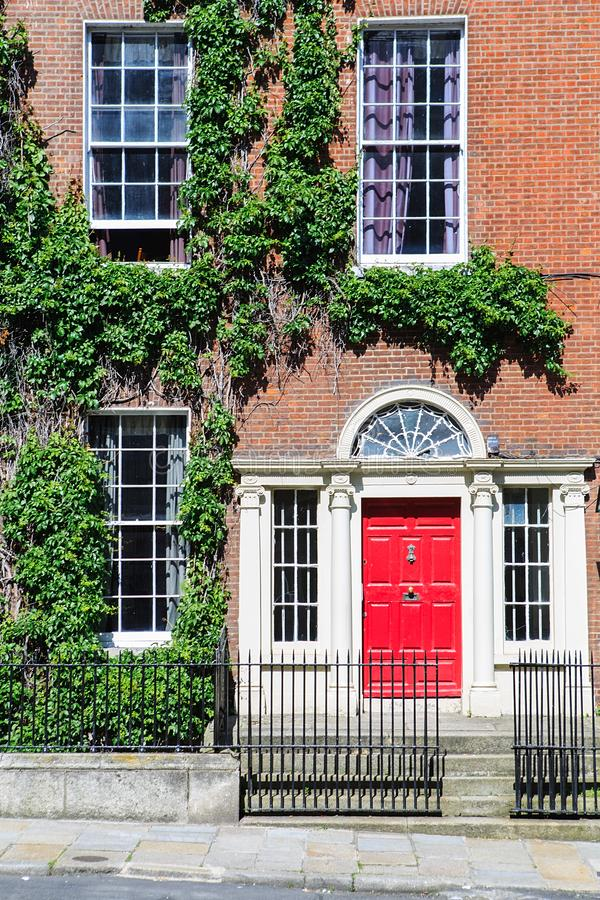 A red door in Dublin, Ireland. Arched Georgian door house front royalty free stock photography