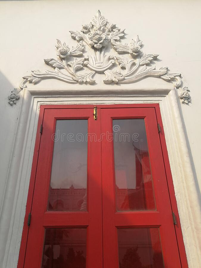 The red door at the entrance to the church royalty free stock images