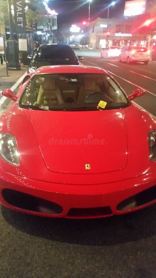 Red 2 door Ferrari stock images