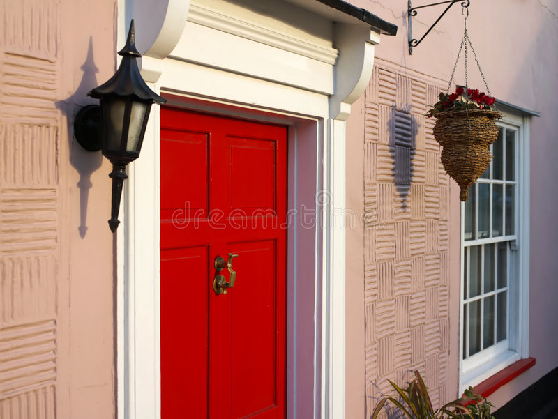 An Old Red Door Lit With Afternoon Sun