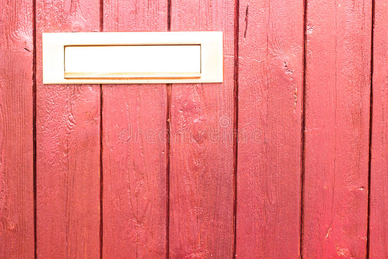 Red door with letter slot mailbox. Abstract stock photos