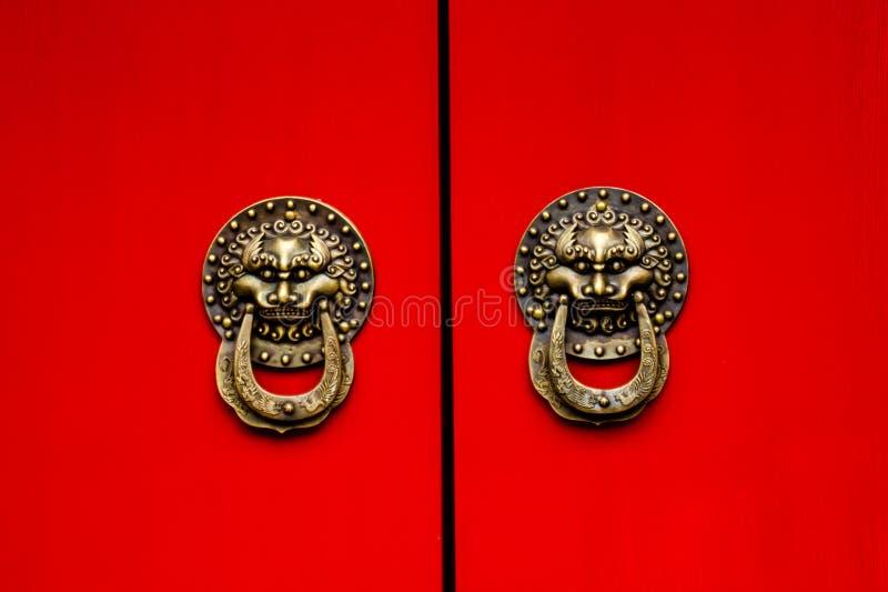 Red Door Ornate Dragon Brass Knockers Houhai Lake Beijing, China royalty free stock image