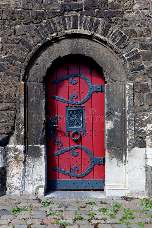 Red door, Ponttor, medieval gate, Aachen, Germany royalty free stock photos