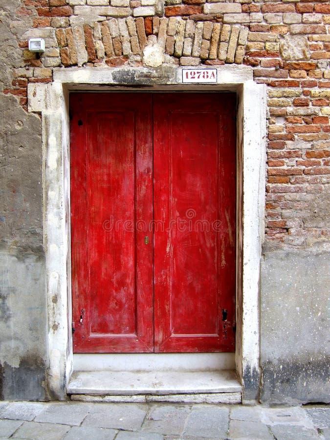 Red door in Venice royalty free stock images