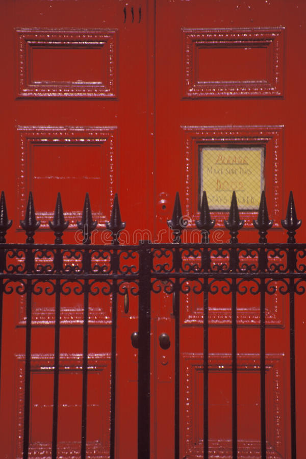 Red door and wrought iron gate at a West Village Boarding School, NY stock images