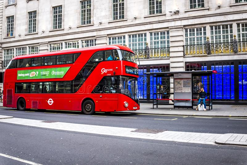 Red double decker bus in Oxford Street, London royalty free stock images