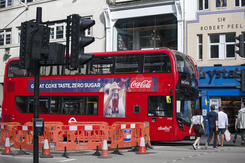 Red double-decker bus stops at a traffic light near Liverpool street. LONDON, ENGLAND - August 20, 2017 red double-decker bus stops at a traffic light near stock image