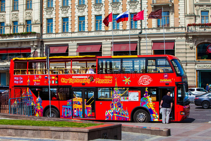 Red double-decker tour bus on Moscow street royalty free stock images