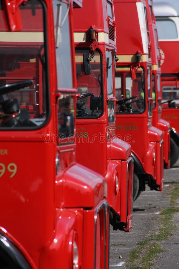 Red Double Deckers. London red double decker routemaster buses parked in a row royalty free stock photo