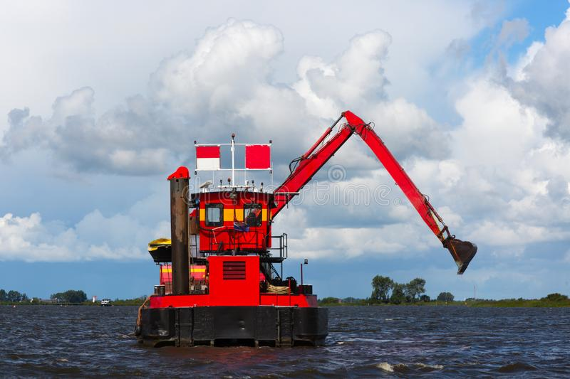 Red dredger stock photography