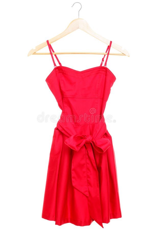 Red dress on hanger isolated royalty free stock photography