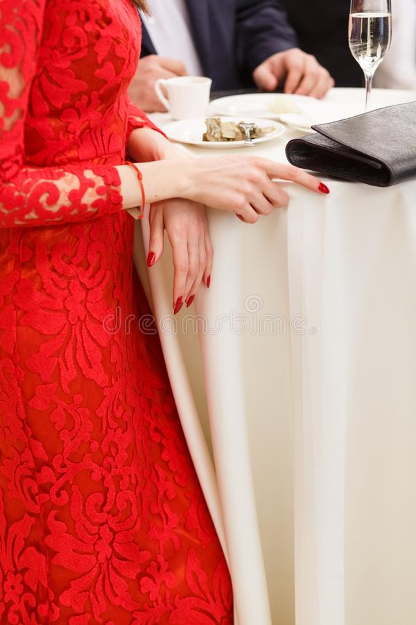 Red dress and red nails royalty free stock photos