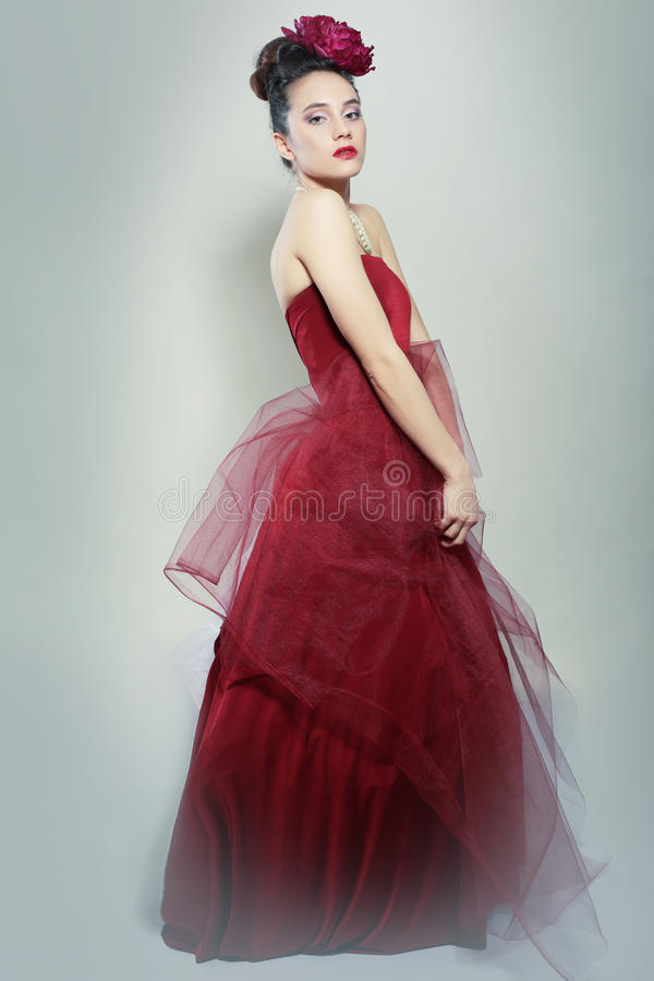 Red dress posing stock photos