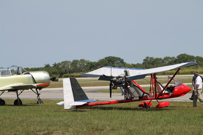 Red drifter plane. Red light prop engine aircraft on field at airport. modern kit plane Lockwood Rotax 912 Drifter at 2014 Memorial Day, Miami, Florida stock photography