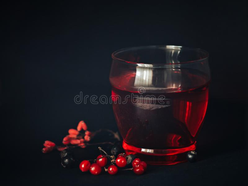 Red drink in a glass stock image