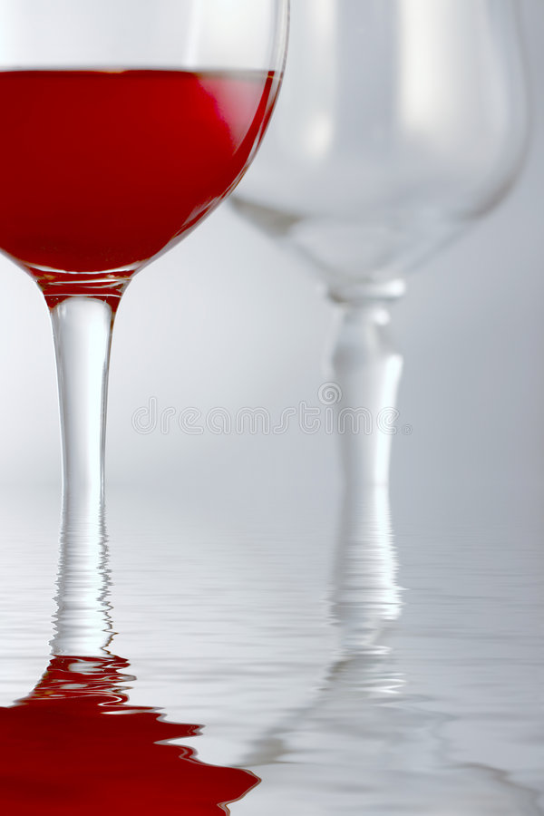 Red drink in glass in water royalty free stock images