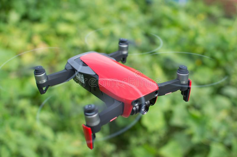 Red drone hovering in the air stock photography