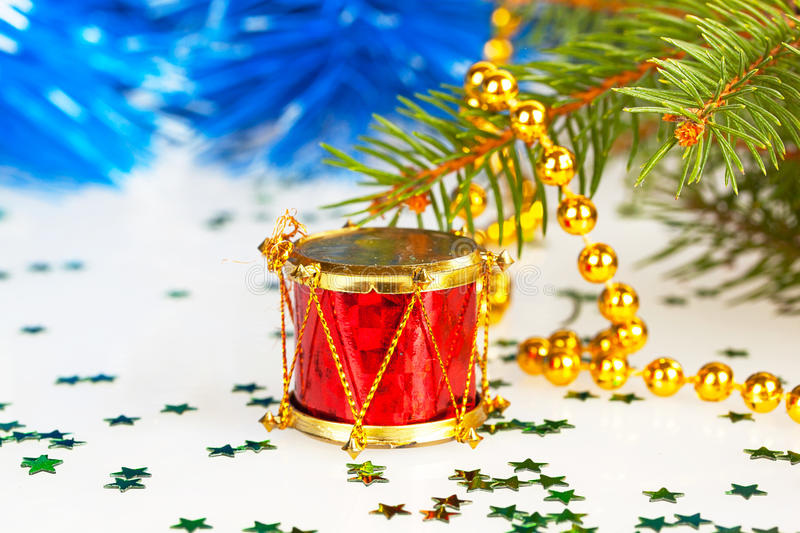 Red drum under the tree. With gold beads royalty free stock photography