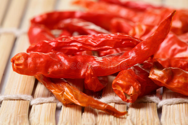 Red dry chillies. Over wooden background stock image