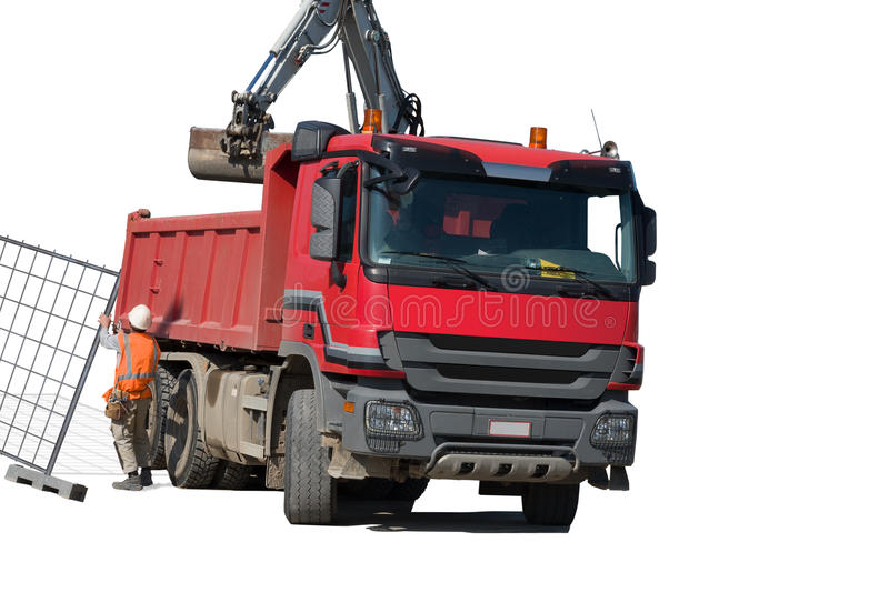 RED dump truck with excavator. Isolated over white background stock images