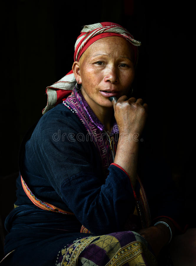 Red Dzao indigenous woman in Sapa 2. Red Dzao tribes is one of the minority tribes in Sapa, Vietnam. 2012 Clothes made of hemp dyed indigo juice, so you can see royalty free stock images