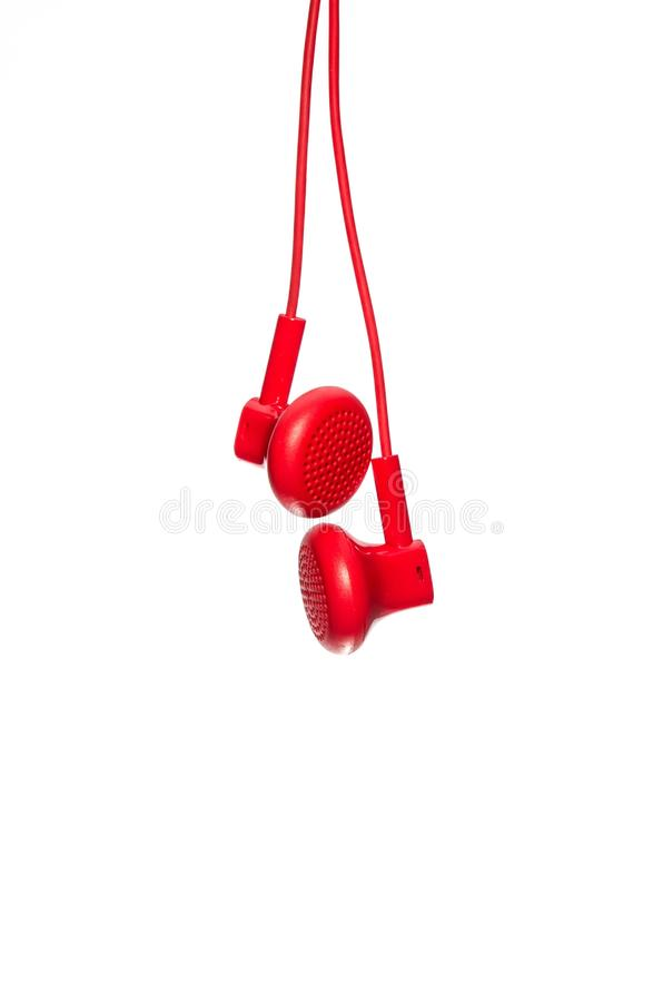 Red Earphone. Isolated on white background stock photos