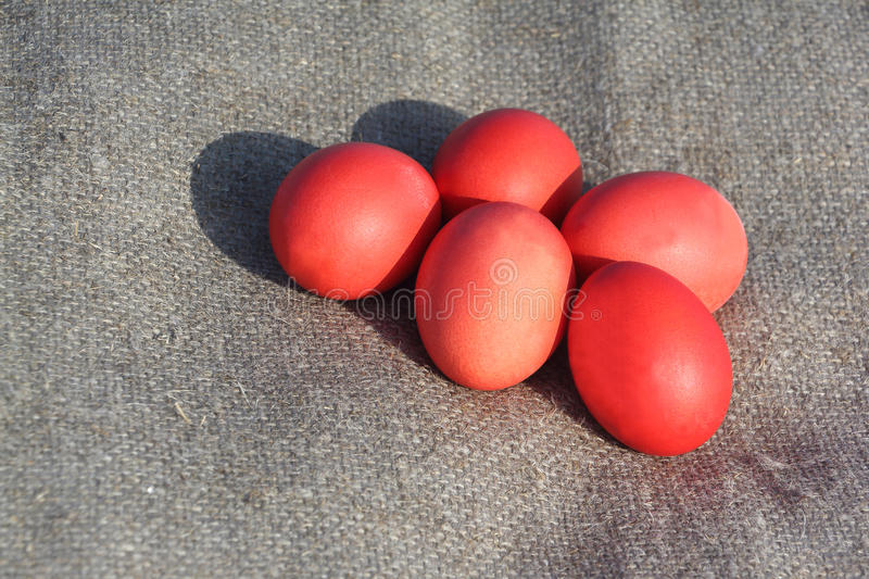 Red Easter eggs on a brown napkin stock photos