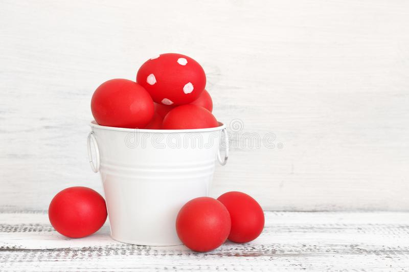 Red Easter eggs in bucket royalty free stock images