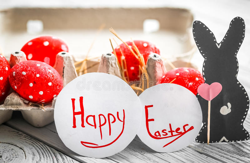 Red Easter eggs and rabbits stock photography