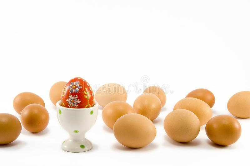 The red egg in egg-cup stock photos