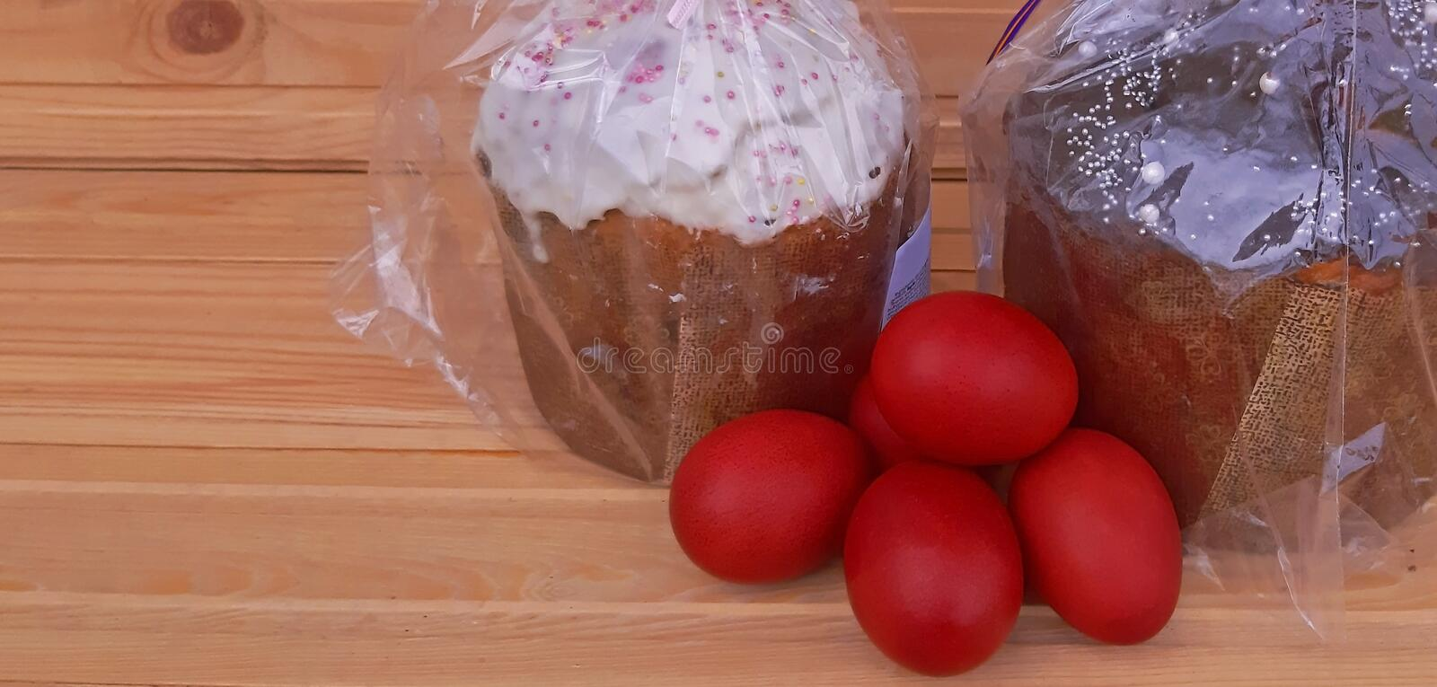 Red eggs and Easter cakes. Easter holiday royalty free stock images