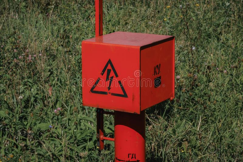 Red electric cable stands in the field. Voltage, electricity, current, technology, construction, high, energy, distribution, power, danger, equipment royalty free stock photo