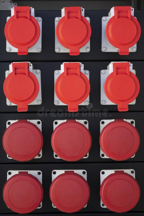 Red electronic power connected to a temporary outdoors royalty free stock images
